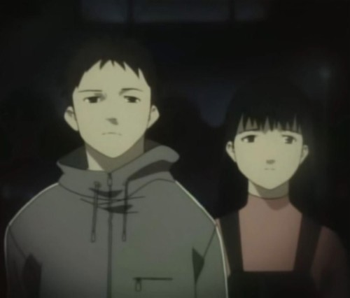 Mamoru and Sayoko Oikawa standing and observing