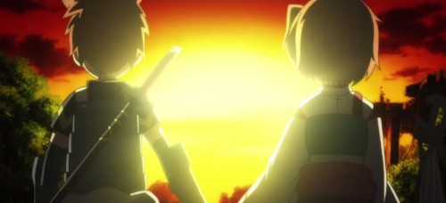 Tohya and Minori facing a sunset