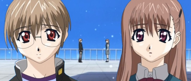 A close-up of Kei Kusanagi's and Kozue Kusanagi's faces against a sky blue background with them standing on a white rooftop